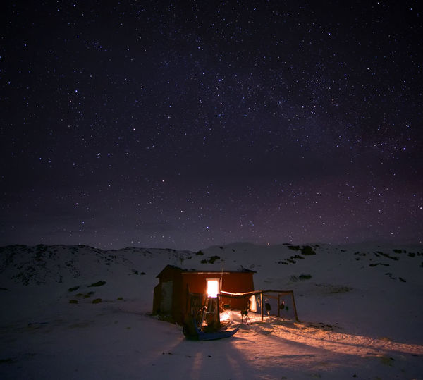 The ultimate getaway Remote EyeEmNewHere Disko Bay Greenland Huskies Inviting Winter Arctic Beauty In Nature Cold Cosy Fishing Hut Illulissat Illuminated Nature Night No People Outdoors Sky Snow Star - Space