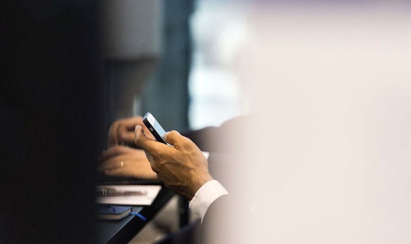 Businessman Communication Hand Hand On Mobile Phone Hands On Comp Human Body Part Human Hand Indoors  Selective Focus Technology Wireless Technology Writing