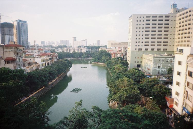 Diplomatic Academy Of Vietnam Film Kodak Vietnam View Architecture Building Building Exterior Built Structure Canon City Cityscape Day Film Photography Filmcamera Filmisnotdead Modern Outdoors Sky Skyscraper Tree View From 7th Water