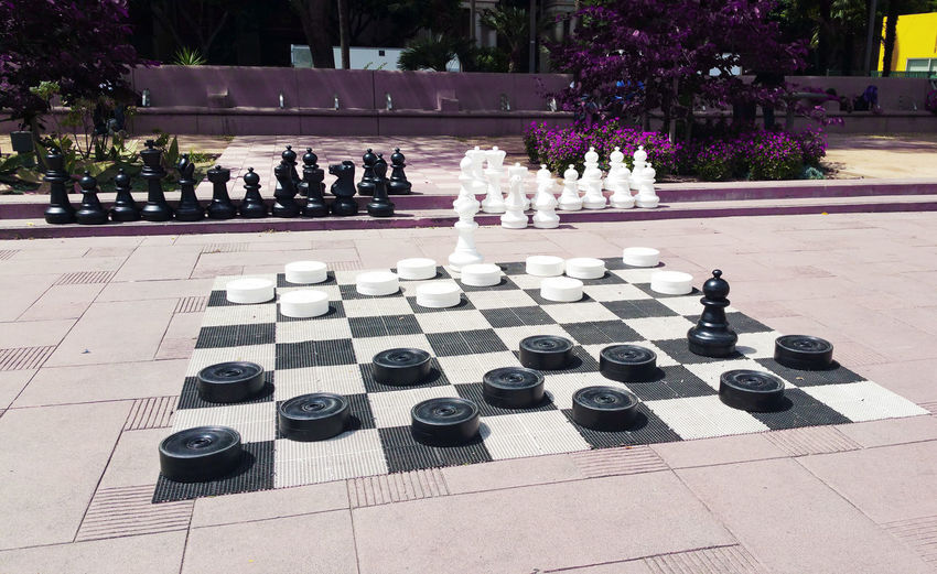 High angle view of people on chess board