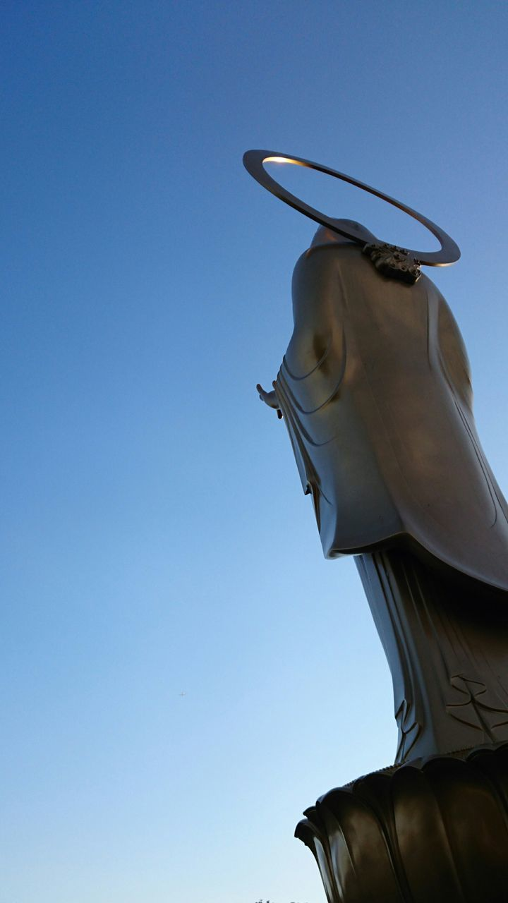 statue, low angle view, clear sky, sculpture, blue, no people, day, outdoors, sky, close-up