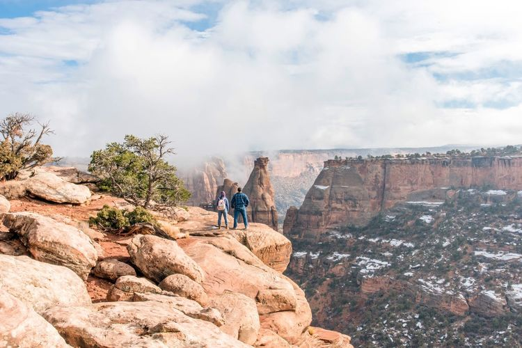 Taking in a spectacular view God's Beauty Rock - Object Nature Sky Real People Day Outdoors Leisure Activity Cloud - Sky Beauty In Nature Rear View Adventure Full Length Landscape Scenics People Adult Lifestyles Cliff Mountain