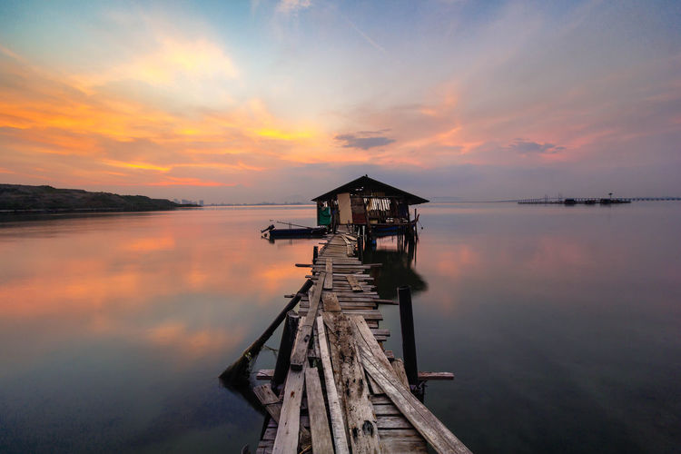 Water Sky Sunset Beauty In Nature Scenics - Nature Cloud - Sky Tranquil Scene Tranquility Reflection Lake Nature Wood - Material Pier Orange Color Idyllic Architecture No People Built Structure Non-urban Scene Outdoors