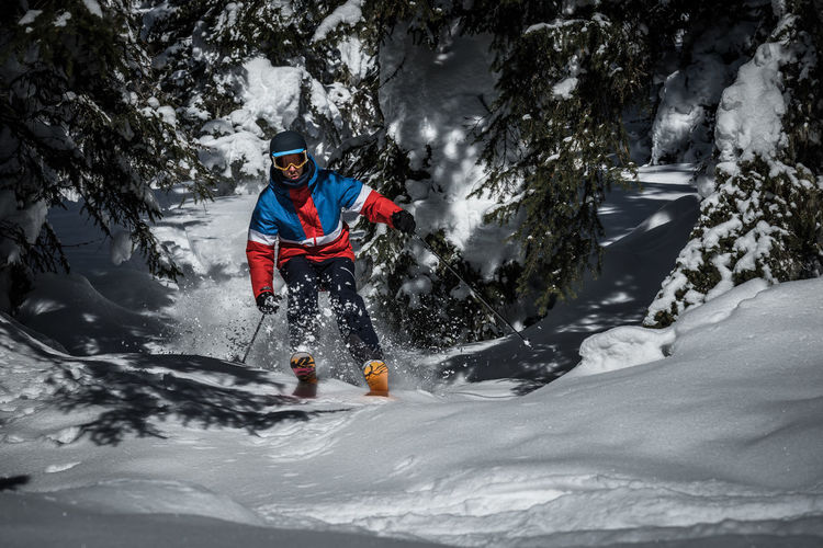 Sport Winter Cold Temperature Snow Mountain Leisure Activity Winter Sport One Person Adventure Tree Vacations Motion Full Length Holiday Extreme Sports Skill  Nature Mountain Range Vitality Ski-wear Outdoors Warm Clothing