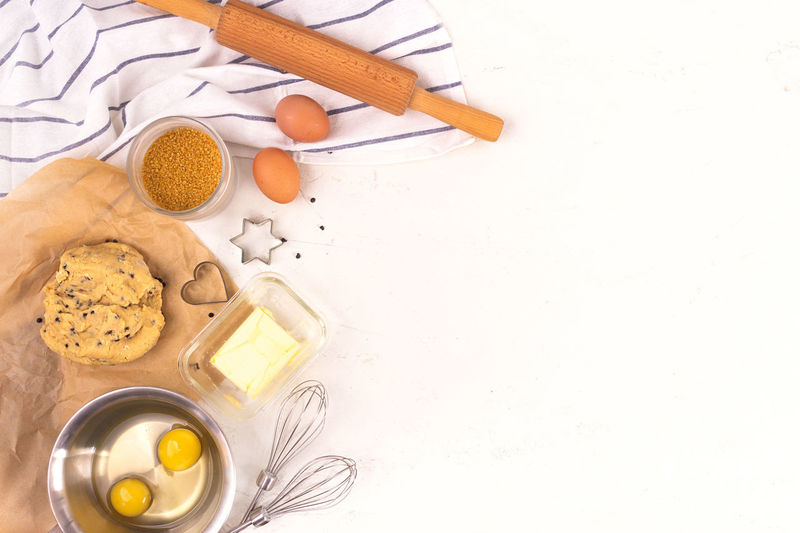 High angle view of breakfast on table against white background