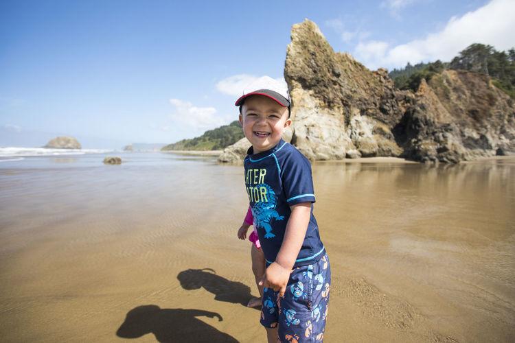 Portrait of boy standing in water