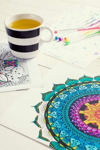 Adult colouring book, new stress relieving trend, flat lay background Adult Art And Craft Books Calming Creativity Relief Stress Therapy Background Book Colouring  Colouring Book Concept Empowering Escape Flat Lay Hobby Leisure Time Lifestyles Mindfulness Relax Relaxation Self Care  Top View Unplugged