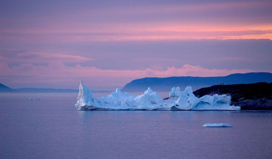 Icebergs In Sea During Sunset