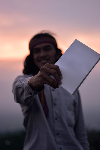 Man and white book