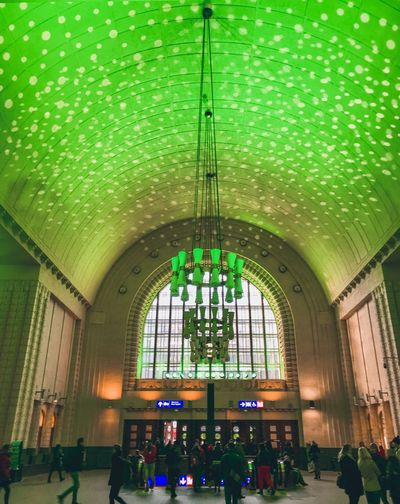 Helsingborg  Finland Helsinki,finland Helsinki Railway Station Green Green Color ShotOnIphone Architecture Built Structure Arch Indoors  Glass - Material Window Day Lighting Equipment Incidental People Lifestyles Religion Group Of People Green Color Glass Real People Ceiling Men Building