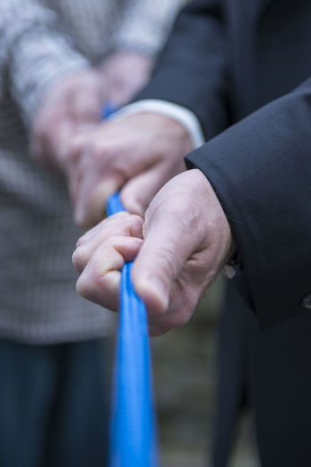 Close-up of people holding hands