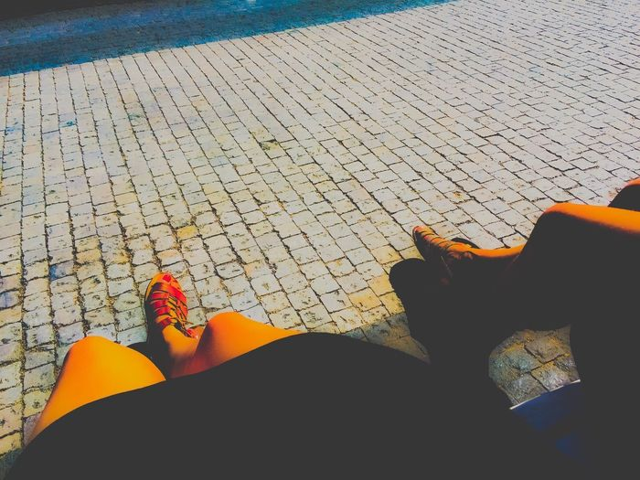 Legs Bench Chilling Waiting Low Section High Angle View Sunlight Real People Lifestyles Shadow Personal Perspective Women Outdoors Summer Road Tripping