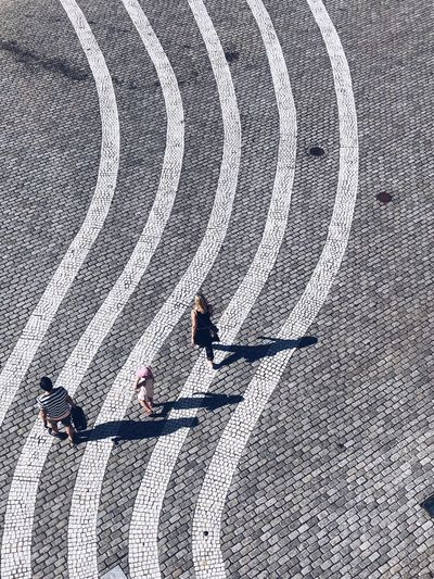 familia Lines Shadow High Angle View Sunlight Day Pattern Unrecognizable Person Street City Real People People Lifestyles Road Focus On Shadow Outdoors The Street Photographer - 2018 EyeEm Awards Summer In The City
