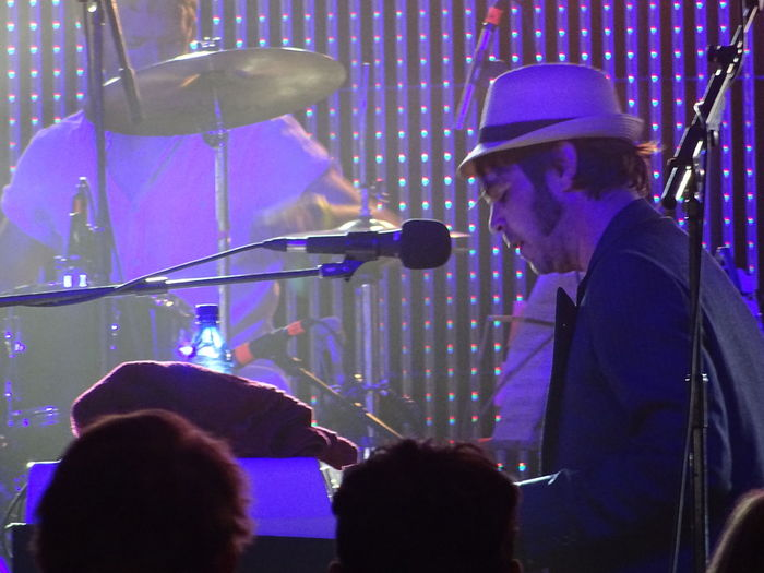 Arts Culture And Entertainment Blue Blue Light Festival Season Gaz Coombes Glastonbury 2014 Hat Illuminated Keyboard Silhouetted Festival Goers