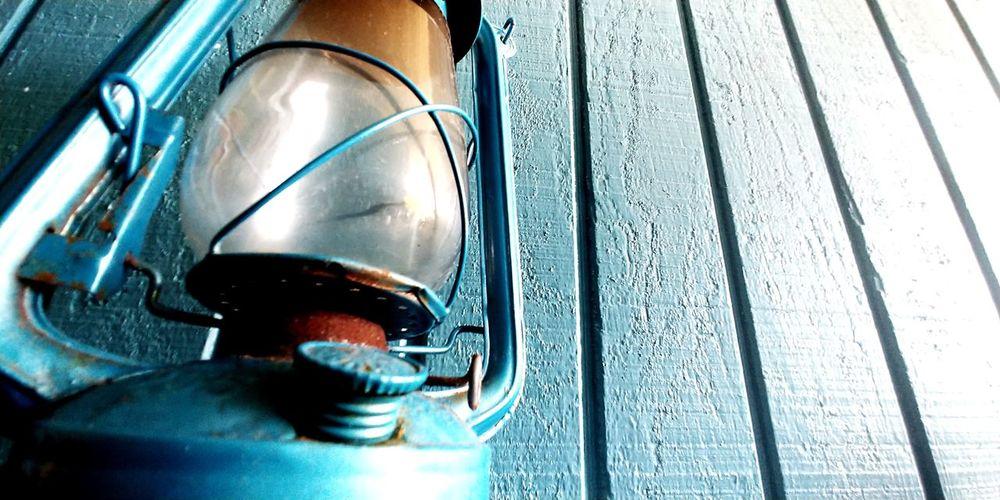 Rusty Blue Kerosene Lantern, Blue Wall Wood Camping Camp Beach Hurricane Lantern Hurricane - Storm Blue Lantern Copy Space Lantern Camp Lantern Kerosene Lamp Kerosene Blue Turquoise Colored Ocean