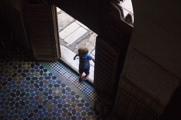 Boy standing in corridor