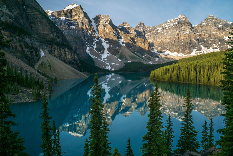 Moraine Lake sunrise at Banff National Park, Canada. Moraine Lake  National Park Beauty In Nature Day Lake Mountain Mountain Range Nature No People Outdoors Reflection Scenics Sky Snow Tranquil Scene Tranquility Turquoise Water Waterfront