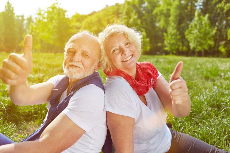 Portrait Of Smiling Senior Couple At Public Park