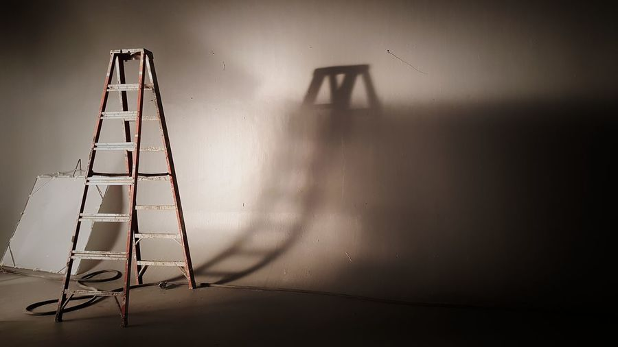 Ladder by wall in room
