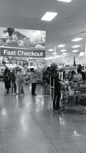 Oh....the irony Store Retail  Supermarket Adults Only People Black And White Monochrome Standing Waiting Streetphotography Life Shoppers The Street Photographer - 2017 EyeEm Awards Black And White Friday
