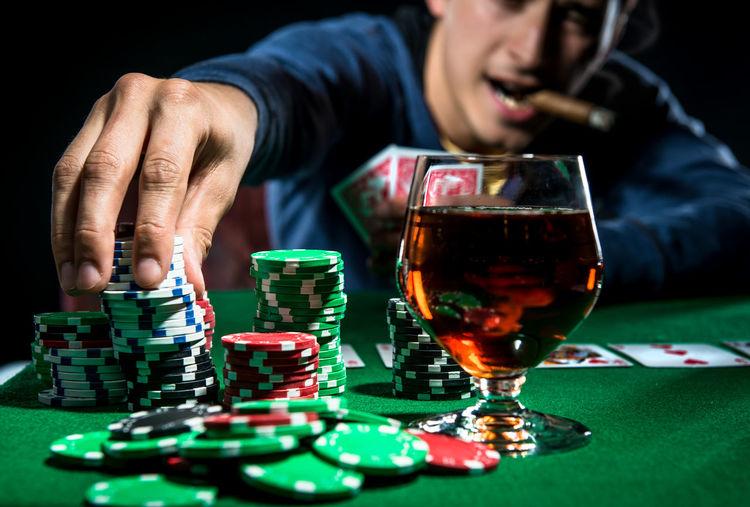 Poker player. Gambling concept Blackjack Casino Gambling Jackpot Man Poker Addiction Alcohol Cigar Entertainment Gambler Gambling Chip Game Leisure Games Male Player Playing Playing Card Games Poker - Card Game Poker Chips Poker Game Real People Studio Shot Table Young Adult