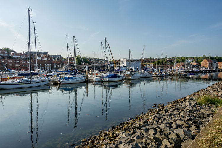Whitby Whitby Harbour Whitby View Whitby North Yorkshire North Yorkshire Yorkshire Tourist Destination Sunny Day Blue Sky Seaside Seaside Town Harbor Sea Port Yacht Marina Outdoors No People Reflection Nautical Vessel Sailboat Transportation Mode Of Transportation Water Sky