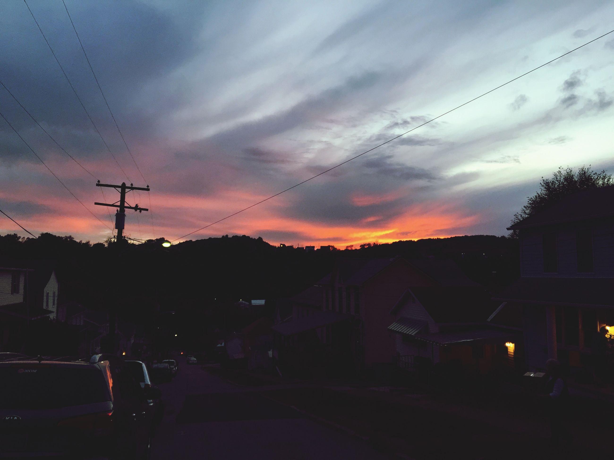 sunset, sky, silhouette, electricity pylon, cloud - sky, power line, building exterior, transportation, built structure, architecture, house, dusk, cloudy, cloud, car, street light, electricity, road, mode of transport, street