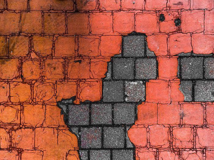 Full frame shot of cracked brick wall