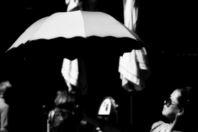 Men Umbrella Protection Males  People Adult The Street Photographer - 2018 EyeEm Awards Portrait Real People Focus On Foreground Side View Women Lifestyles Incidental People