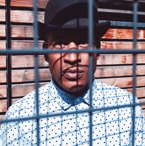 Portrait Of Man Through Fence