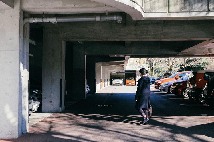 Full length of woman walking at parking lot