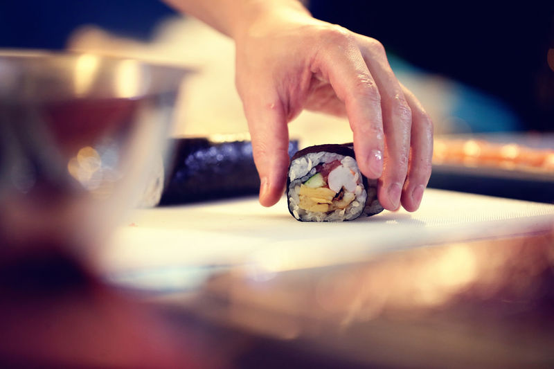 Cropped Image Of Chef Preparing Sushi In Restaurant