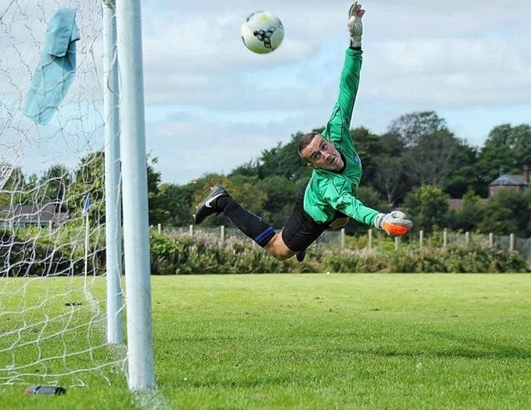 Goal Keeper Mid-air Full Length One Person Soccer Ball Motion Jumping Playing Sport Agility Kicking One Man Only Scoring A Goal Soccer Ball Football Soccer Life Grass Goalposts Goal Goals Football Life Football Time  Save Mid-air
