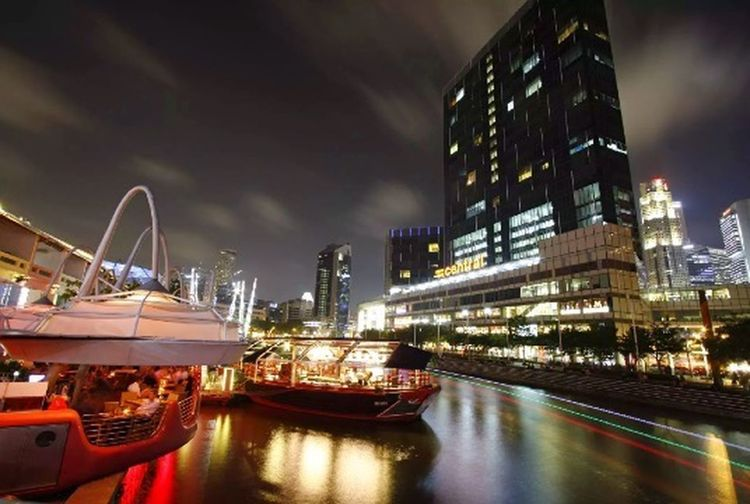"The hustle and hustle of night life at Clarke Quay/ Boat Quay, Singapore. Love the movement of the clouds in the sky. Taken with Canon + Wide Angle lens. ISO100. F10. 30"". No flash. (Felt like a tourist for a day. Ended up chatting with a tourist who thought I was a foreigner!!) Cityscapes Nightphotography Longexposure Singapore"