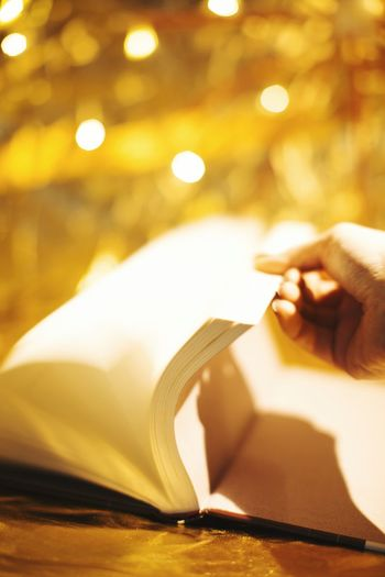 Human Hand Close-up Book Christmas Christmastime Shiny Golden Gold Christmaslights Christmasspirit Weihnachten Weihnachtsbäckerei Candlelight Backing Backery ChristmasStories ChristmasMagic Magic Magical
