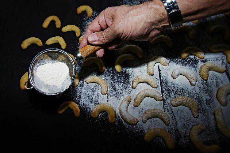 High angle view of man preparing cookies
