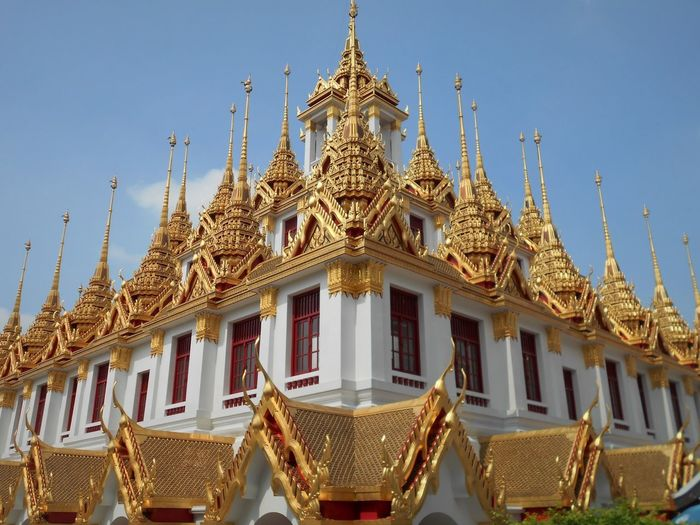 Architecture Gold Colored Religion Belief Spirituality Sky Place Of Worship Built Structure Low Angle View Gold Travel Destinations Day Ornate No People Loha Prasat