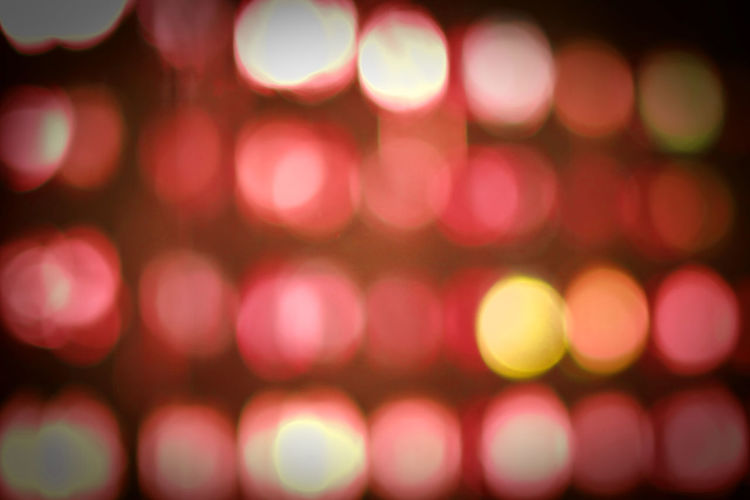 Illuminated Defocused Abstract Lighting Equipment Backgrounds Night Glowing Pattern No People Light Geometric Shape Circle Vibrant Color Spotted Decoration Textured  Celebration Light Bulb Light Effect Shape Electricity  Textured Effect Purple Nightlife Brightly Lit Red Color