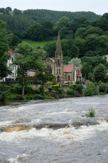 Architecture Beauty In Nature Building Exterior Built Structure Day Green Color Growth Hill Landscape Llangollen Methodist Church Lush Foliage Mountain Nature No People Outdoors Relaxing Scenics Sky Tourism Town Tranquil Scene Tranquility Travel Destinations Tree White Wall