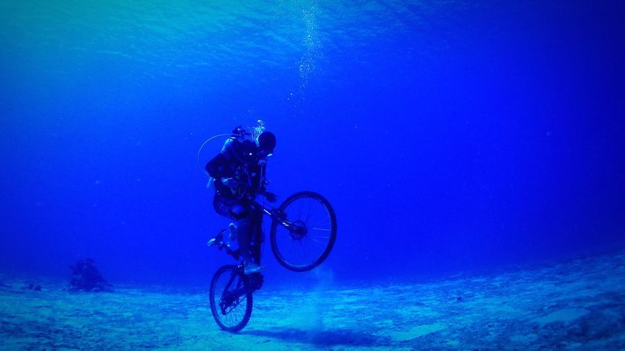 SCUBA Nature Nature Photography Scuba Diving Ride Jump Bike Bycicle Blue Underwater Relaxing Earth Traveling Photography Saipan Light Ocean Wide Angle Diver Beautiful Diving Sport Adventure Club The Color Of Sport