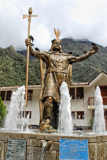 "monument to the Inca ""The great Pachacutec"". Inca Pachacutec Water Religion Spirituality Sky Architecture Fountain Statue Human Representation"