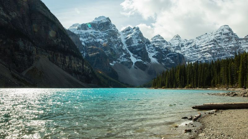 Moraine Lake, Lake Louise, Alberta Mountain Scenics Nature Snow Beauty In Nature Mountain Range Sky Tranquil Scene Outdoors Tranquility Rock - Object Day Cloud - Sky Winter Lake Travel Destinations Cold Temperature Rocky Mountains Landscape Water EyeEmNewHere