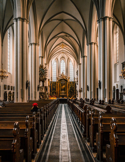 Religion Place Of Worship Pew Belief Built Structure Architecture Indoors  Spirituality Building In A Row Arch The Way Forward Architectural Column Direction Bench Aisle Ceiling Abbey Gothic Style