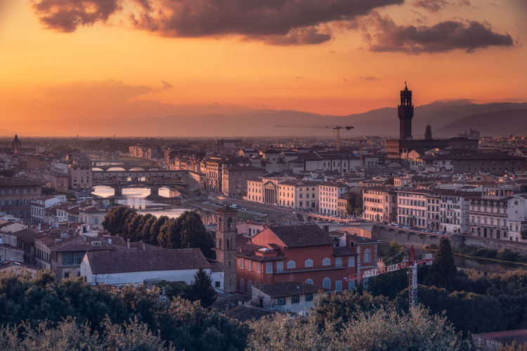 Sunset in Florence, Italy Florence Italy Landscape_Collection Travel Photography Architecture Bridge Bridge - Man Made Structure Building Exterior Built Structure City Cityscape Cloud - Sky Connection Florence High Angle View Landscape Landscape_photography Nature No People Orange Color Outdoors River Sky Sunset Tourism Travel Destinations