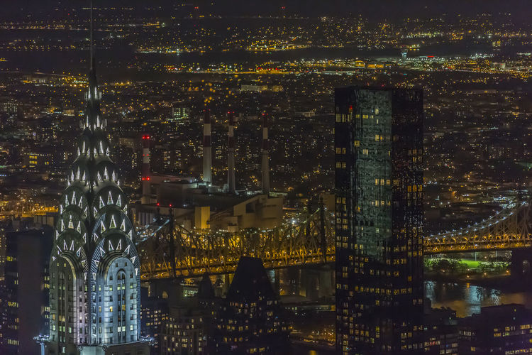 Parts of Manhattan, Queensboro bridge and beyond East river at night as seen from Empire State Building Night Architecture Building Exterior Built Structure City Illuminated Cityscape Water Building Residential District No People Aerial View Office Building Exterior Skyscraper City Life Modern Outdoors Reflection Financial District  Chrysler Building Empire State Building Queensboro Bridge Sandy Storm