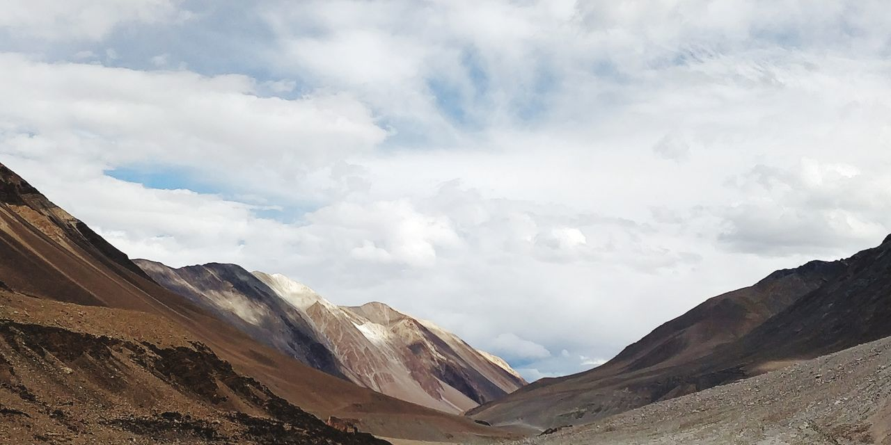 Ladhak India Ladhakh Nature Snow EyeEm Selects Mountain Desert Sand Dune Sand Sunlight Sky Landscape Cloud - Sky Rocky Mountains Mountain Peak Natural Landmark Eroded Extreme Terrain Rock Formation