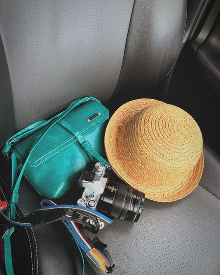 Travel items Camera Gadget Travel EyeEm Selects Hat Still Life High Angle View Indoors  No People Clothing Straw Hat Bag Sun Hat Personal Accessory Fashion