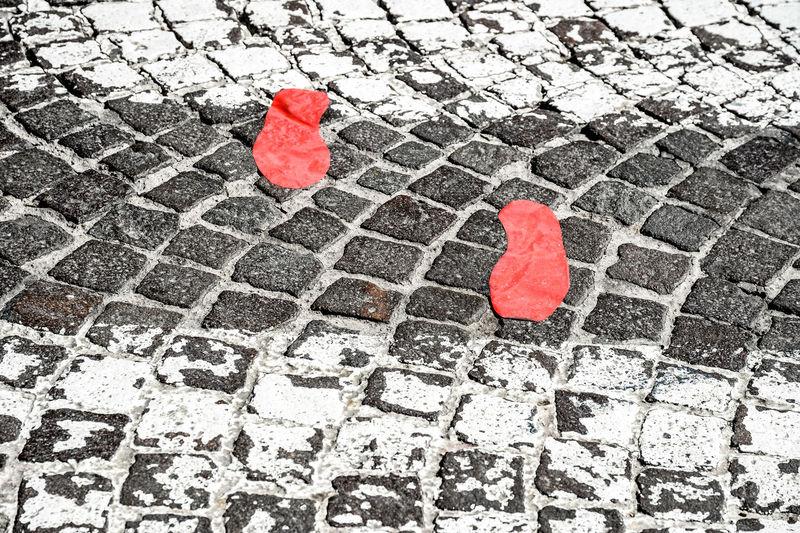 Red Footprint On Walkway