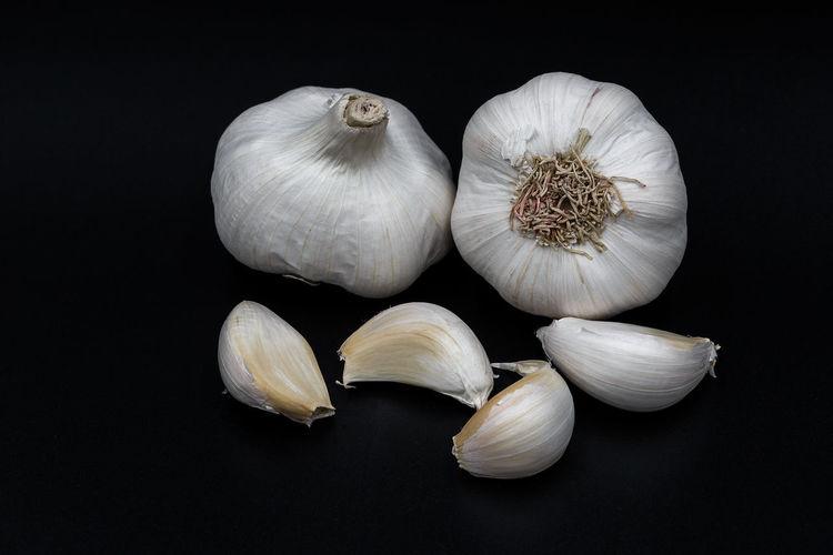 Close-up of garlic against black background