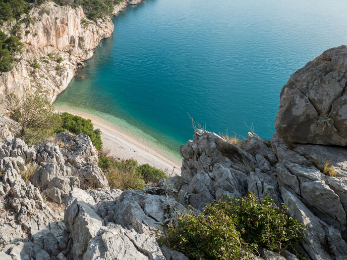 View at empty hidden beach and calm blue sea from the cliff Rock Rock - Object Water Sea Beauty In Nature Nature Scenics - Nature Day Tranquility No People High Angle View Beach Cliff Outdoors Rocky Coastline Hidden Summer Ocean Scenics Landscape Makarska Makarska Riviera Dalmatia Croatia Europe Adriatic Sea Mediterranean  Above Nature Natural Nugal